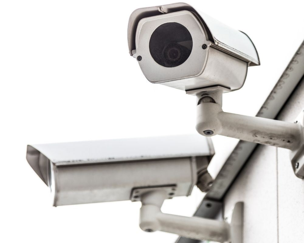 Alarm system camera attached to a building
